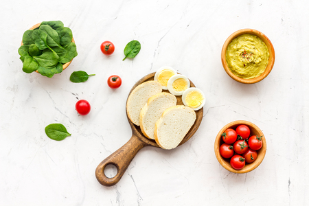 Healthy breakfast. Toasts with vegetables and guacamole on white background top view Stock Photo