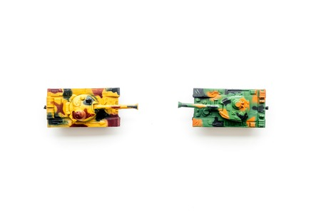 War concept. Tanks toy on white background top view copy space