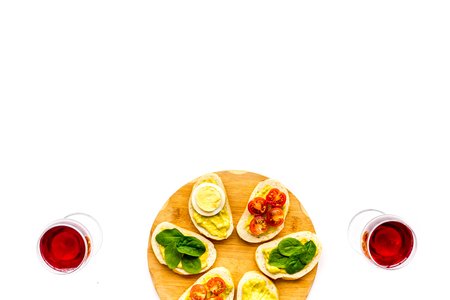 Healthy snacks. Set of toasts with vegetables like avocado, guacamole, rocket, cherry tomatoes on white background top view. Reklamní fotografie