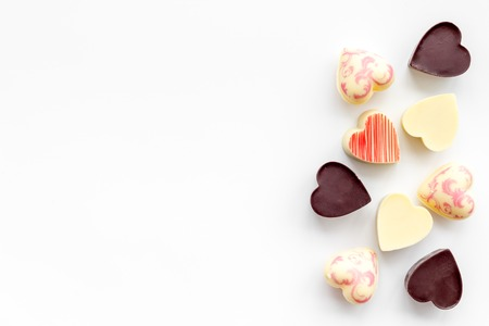 Heart-shaped confection for Valentines day on white background top view copy space