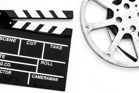 Filming concept. Clapperboard and film stock on white background top view space for text
