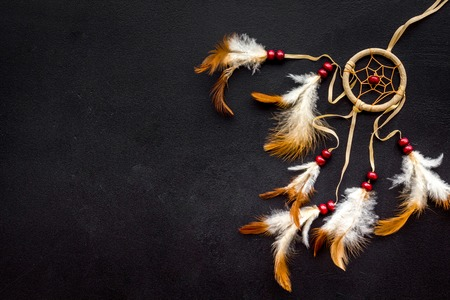 Asian attributes. Dream catcher on black background top view copy space