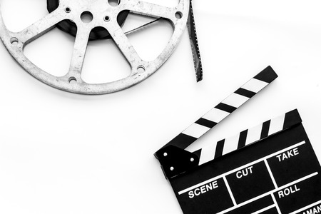 Filming concept. Clapperboard and film stock on white background top view space for text Banque d'images - 116257439