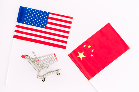USA and China trade war. American and Chinese flags near shopping chart on white background top view Stock Photo