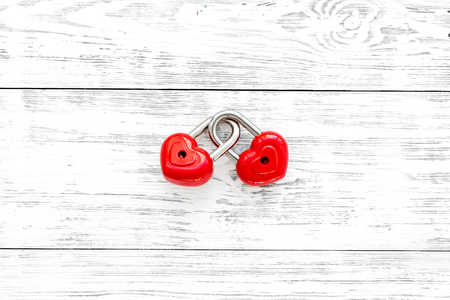 Love concept. Valentines day symbol. Locks in shape of heart on white wooden background top view space for text