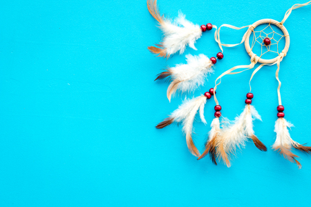 Asian attributes. Dream catcher on blue background top view space for text 스톡 콘텐츠