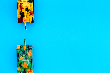 War concept. Tanks toy on blue background top view space for text Stock Photo