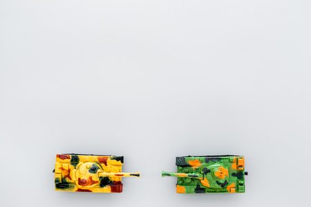 War concept. Tanks toy on grey background top view space for text Stock Photo