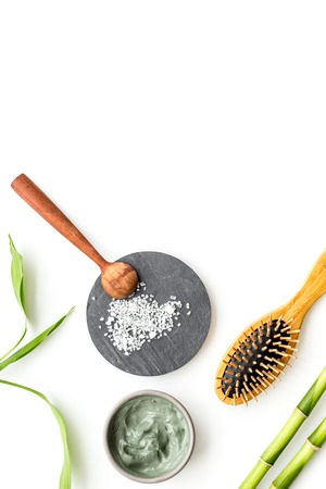 Skin cleansing and detox. Bamboo charcoal powder cosmetics on white background top view copy space Stock Photo - 116443447