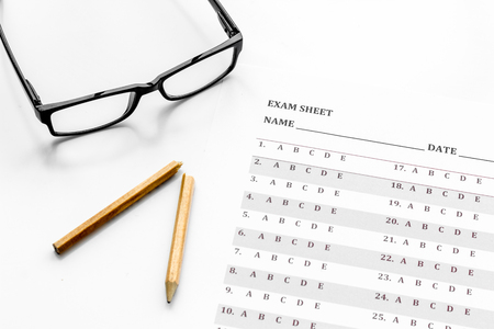 Take the exam. Exam sheet near glasses and pencil on white background Stock Photo