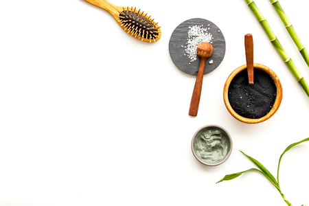 Skin cleansing and detox. Bamboo charcoal powder cosmetics on white background top view copy space