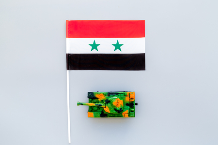 War, military threat, military power concept. Syria. Tanks toy near Syrian flag on grey background top view copy space Stock Photo - 116880244