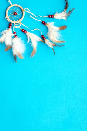 Asian attributes. Dream catcher on blue background top view.