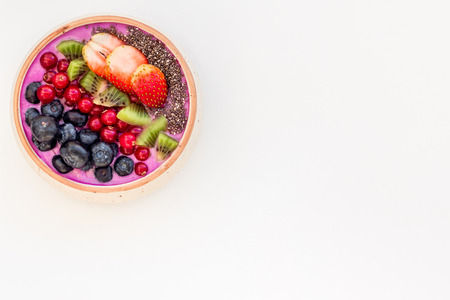 Superfoods. Acai smoothie bowl with fresh fruits, berries, chia seeds white background top view copy space