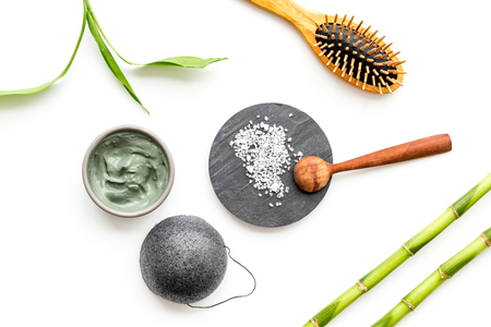 Skin cleansing and detox. Bamboo charcoal powder cosmetics on white background top view.