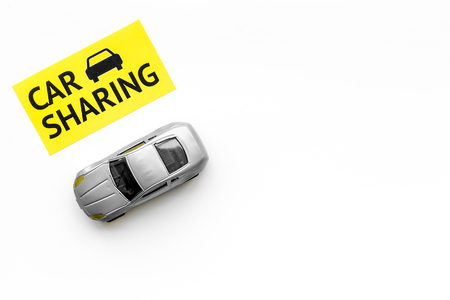 Car sharing concept. Toy car near text car sharing on white background top view space for text Stock Photo