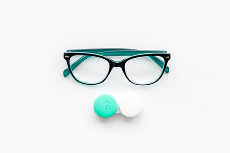 Eyes care. Glasses with transparent lenses and contact lenses on white background top view. Imagens