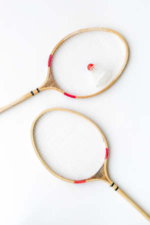 Badminton concept. Badminton rackets and shuttlecock on white background top view Stock Photo