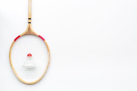 Badminton concept. Badminton racket and shuttlecock on white background top view space for text