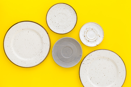 Mockup with plates. Empty ceramic plates on yellow background top view copy space Stock Photo