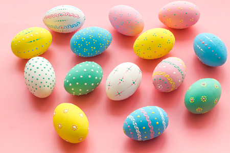 Colorful Easter eggs background on pink background Stock Photo