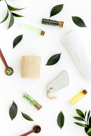 Spa composition with essential tea tree oil. Fresh tea tree leaves, natural cosmetics, towel on white background top view