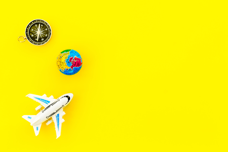 SOS Save the planet and eco concept with the earth, plane and compass on white background flat lay mock up 版權商用圖片