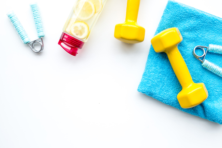 Sport with bars, towel, water and wrist builder on white background top view space for text 写真素材