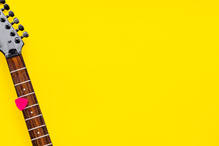 Music record studio with musician and DJ instruments on yellow background top view copyspace
