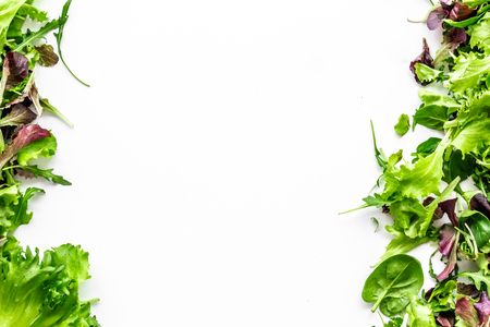 Organic food pattern with green and red salads mix on white background top view space for text