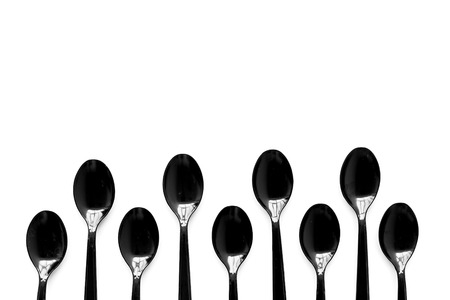 Go green. Plastic spoons for eco and Earth protection concept on white background top view mockup