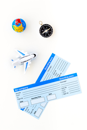 SOS Save the planet concept with the earth, ticket, plane and compass on white background top view flat lay space for text.