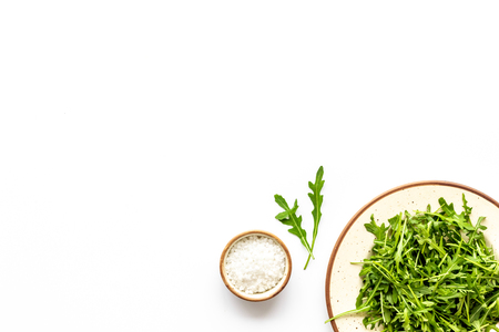 Organic food pattern with green salads mix on white background top view space for text