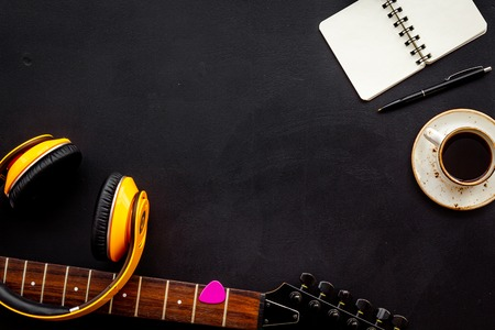 Music record studio with musician and DJ instruments on black background top view copyspace