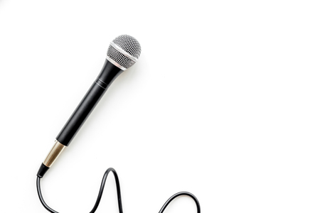 Microphone for blogger, journalist or musician work on white office table background top view mock up