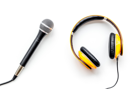 Microphone and headphones for blogger, journalist or musician work on white office table background top view Stock Photo