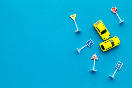 Car insurance concept with car toys on blue desk background top view copyspace 写真素材
