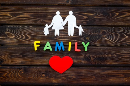 Family copy and figures on wooden table background top view
