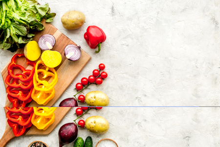 Vegan food cooking with raw vegetables on white stone table background top view mock up Stock Photo