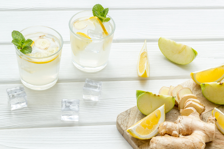 Healthy drinks with apple and lemon for summer on white wooden background Imagens