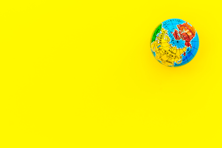 SOS Save the planet concept with the earth on yellow background flat lay mockup Stock fotó