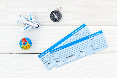 SOS Save the planet and ecology concept with the earth, compass, tickets and plane on white background top view