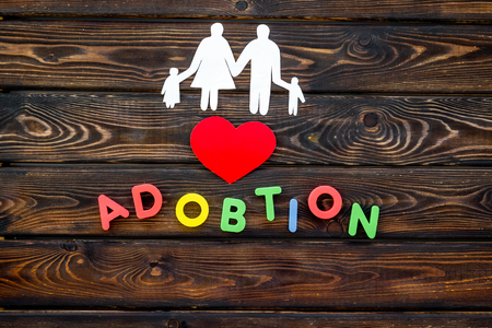 Family concept and adoption child copy on wooden table background top view