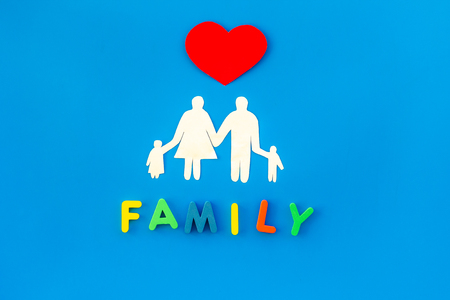 Family copy and adoption child concept on blue table background top view