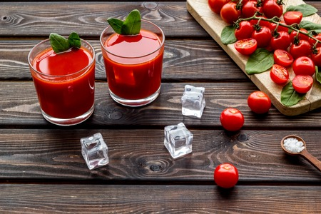 Tomato juice for summer healthy drink on wooden table background
