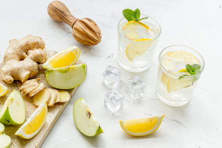 Healthy organic drinks with apple and lemon for summer on white background