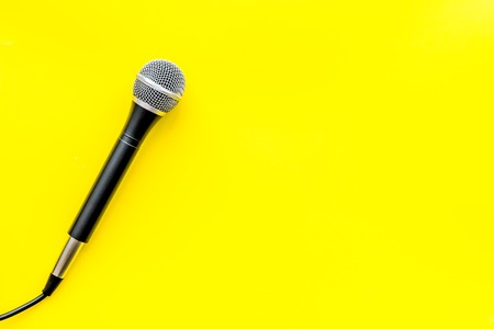 Blogger, journalist or musician office desk with microphone on yellow studio background top view copyspace Stock Photo - 119339900