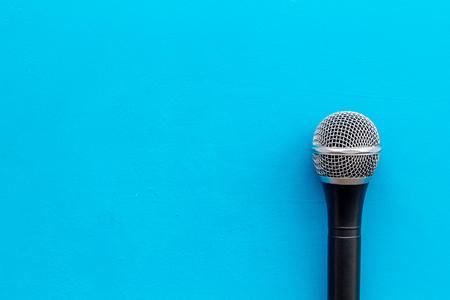 Podcast record with microphone on blue office desk background top view space for text Stock Photo