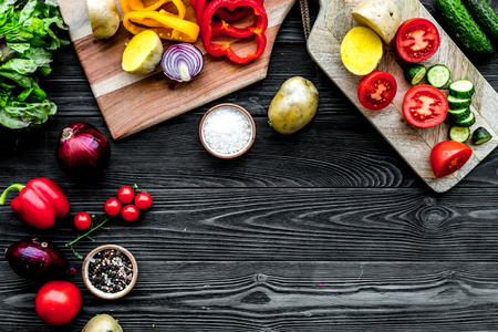 Cooking with raw vegetables on dark wooden background top view mockup