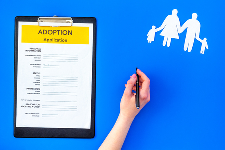 Family and adoption child concept with application on blue table background top view